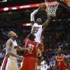 Photo - Miami Heat's LeBron James (6) goes around Chris Andersen( 11) and Houston Rockets' Dwight Howard (12) for a two point shot during the first half of an NBA  basketball game in Miami, Sunday, March 16, 2014. (AP Photo/J Pat Carter)
