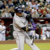 Photo - Colorado Rockies' Troy Tulowitzki connects for a two-run home run against the Arizona Diamondbacks during the sixth inning of a baseball game on Tuesday, April 29, 2014, in Phoenix. (AP Photo/Ross D. Franklin)