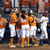 Photo - Tennessee celebrates their as Texas' Brejae Washington walks off the field during Women's College World Series softball game at ASA Hall of Fame Stadium in Oklahoma City, Sunday, June, 2, 2013. Photo by Sarah Phipps, The Oklahoman Download