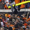 An Oklahoma State fan rides the goal post after the Cowboys\' 44-10 win over Oklahoma during the Bedlam college football game between the Oklahoma State University Cowboys (OSU) and the University of Oklahoma Sooners (OU) at Boone Pickens Stadium in Stillwater, Okla., Saturday, Dec. 3, 2011. Photo by Chris Landsberger, The Oklahoman