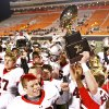 TULSA UNION / HIGH SCHOOL FOOTBALL / CELEBRATION / TROPHY: The Union Redskins celebrate their win over Broken Arrow in the high school Class 6A state championship football game in Stillwater, Okla. on Thursday, December 1, 2011. MATT BARNARD/Tulsa World ORG XMIT: DTI1112012318190592