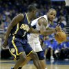 Photo -   Orlando Magic's Jameer Nelson, right, looks to pass the ball as he is guarded by Indiana Pacers' Darren Collison (2) during the first half of Game 3 of an NBA first-round playoff basketball series, Wednesday, May 2, 2012, in Orlando, Fla. (AP Photo/John Raoux)