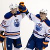 Photo - Edmonton Oilers' David Perron, right, celebrates his third goal against the Vancouver Canucks with teammate Martin Marincin, of Slovakia, during third period NHL hockey action in Vancouver, British Columbia on Monday Jan. 27, 2014. (AP Photo/ The Canadian Press, Darryl Dyck)