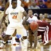 Oklahoma State\'s Fred Gulley (21) and Oklahoma\'s Tommy Mason-Griffin (11) battle for a loose ball in the second half of the college basketball game during the men\'s Big 12 Championship tournament at the Sprint Center on Wednesday, March 10, 2010, in Kansas City, Mo. Photo by Chris Landsberger, The Oklahoman