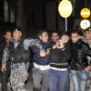 Jordanian anti-riot forces arrest protesters during a demonstration following an announcement that Jordan would raise fuel prices, including a hike on cooking gas in Amman, Jordan, Wed, Nov. 14, 2012. (AP Photo/Mohammad Hannon)