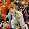 OSU\'s Keiton Page (12) drives the ball away from Texas A&M\'s Dash Harris (5) after a turnover by the Aggies in the first half of a men\'s college basketball game between the Oklahoma State University Cowboys and Texas A&M University Aggies at Gallagher-Iba Arena in Stillwater, Okla., Saturday, Feb. 25, 2012. OSU won, 60-42. Photo by Nate Billings, The Oklahoman
