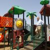 Photo - David Hornbeek, a member of the Rotary Club, stands on the playground equipment after the dedication ceremony on Wednesday. Rotary Club members donated the equipment at the new Edmond 66 Park. Photo by Jim Beckel, The Oklahoman  Jim Beckel - THE OKLAHOMAN