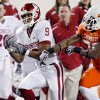 Oklahoma State\'s Quinton Moore (26) breaks up a pass for Oklahoma\'s Juaquin Iglesias (9) during the first half of the college football game between the University of Oklahoma Sooners (OU) and Oklahoma State University Cowboys (OSU) at Boone Pickens Stadium on Saturday, Nov. 29, 2008, in Stillwater, Okla. STAFF PHOTO BY CHRIS LANDSBERGER