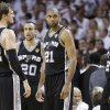 Photo - San Antonio Spurs' Tim Duncan (21), Tiago Splitter (22) Manu Ginobili (20) and Kawhi Leonard (2) take a break during a timeout during the second half of Game 1 of the NBA Finals basketball game against the Miami Heat, Thursday, June 6, 2013 in Miami. (AP Photo/Lynne Sladky)
