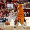 Oklahoma\'s Sam Grooms (1) and Oklahoma State\'s Cezar Guerrero (1) go for a loose ball during the Bedlam men\'s college basketball game between the University of Oklahoma Sooners and the Oklahoma State Cowboys in Norman, Okla., Wednesday, Feb. 22, 2012. Oklahoma won 77-64. Photo by Bryan Terry, The Oklahoman
