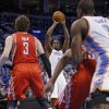 Oklahoma City\'s Kendrick Perkins (5) shoots over Houston\'s Omer Asik (3) during Game 2 in the first round of the NBA playoffs between the Oklahoma City Thunder and the Houston Rockets at Chesapeake Energy Arena in Oklahoma City, Wednesday, April 24, 2013. Photo by Chris Landsberger, The Oklahoman