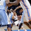 Oklahoma City\'s Russell Westbrook (0) drives past Denver\'s Kenyon Martin (4) during the first round NBA playoff game between the Oklahoma City Thunder and the Denver Nuggets on Sunday, April 17, 2011, in Oklahoma City, Okla. Photo by Chris Landsberger, The Oklahoman