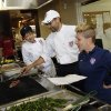 Photo - In this photo taken on May 21, 2014, U.S. soccer dietician Danielle LaFata, right, goes over the lunch menu with the team's chef Bryson Billapando, center, and Stanford chef Clarissa Flores during the team's training in Stanford, Calif., in preparation for the World Cup soccer tournament in Brazil. Billpanado cherishes his World Cup experience after surviving the 2012 Colorado theater shooting. (AP Photo/Marcio Jose Sanchez)