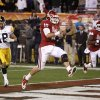 Oklahoma\'s Blake Bell (10) runs past Iowa\'s Micah Hyde (18) for a touchdown as Oklahoma\'s Dejuan Miller (24) watches during the Insight Bowl college football game between the University of Oklahoma (OU) Sooners and the Iowa Hawkeyes at Sun Devil Stadium in Tempe, Ariz., Friday, Dec. 30, 2011. Photo by Bryan Terry, The Oklahoman