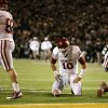 Oklahoma quarterback Blake Bell (10) kneels over the ball after being stopped short of the goal on a fourth-and-goal play in the first half of an NCAA college football game against Baylor, Thursday, Nov. 7, 2013, in Waco, Texas. Oklahoma\'s Brannon Green (82) and Gabe Ikard (64) walk toward the sideline in the 41-12 Baylor win. (AP Photo/Tony Gutierrez)