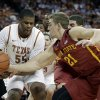 Photo - Iowa State's Matt Thomas (21) pressures Texas' Cameron Ridley (55) during the first half on an NCAA college basketball game, Saturday,  Jan. 18, 2014, in Austin, Texas. (AP Photo/Eric Gay)