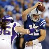 Photo -   Indianapolis Colts quarterback Andrew Luck (12) is pressured by Minnesota Vikings' Brian Robison during the second half of an NFL football game in Indianapolis, Sunday, Sept. 16, 2012. (AP Photo/AJ Mast)