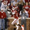 Photo - OU's Quinton Carter intercepts a pass in the fourth quarter of the Big 12 college football game between the University of Oklahoma Sooners and the Kansas State Wildcats at Gaylord Family -- Oklahoma Memorial Stadium in Norman, Okla., Saturday, October 31, 2009.  Photo by Bryan Terry, The Oklahoman ORG XMIT: KOD