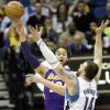 Los Angeles Lakers\' Pau Gasol, left, of Spain, sends a pass over Minnesota Timberwolves\' Nikola Pekovic, of Montenegro, in the first quarter of an NBA basketball game, Friday, Feb. 1, 2013, in Minneapolis. (AP Photo/Jim Mone)