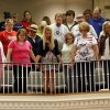 Moore educators, including some from Plaza Towers Elementary, stand and pray at the end of a district-wide meeting of Moore Public Schools employees at Southern Hills Baptist Church, 8601 Pennsylvania Ave., in Oklahoma City, Wednesday, May 22, 2013, after a tornado struck south Oklahoma City and Moore, Okla., on Monday. Photo by Nate Billings, The Oklahoman