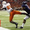 OSU\'s Justin Blackmon (81) makes a touchdown catch as Robert Golden (1) of Arizona defends in the third quarter during the Valero Alamo Bowl college football game between the Oklahoma State University Cowboys (OSU) and the University of Arizona Wildcats at the Alamodome in San Antonio, Texas, Wednesday, December 29, 2010. OSU won, 36-10. Photo by Nate Billings, The Oklahoman