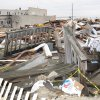 A shattered walkway is all that remains of a house in Sea Bright N.J., shown here on Jan. 15, 2013, that was destroyed by Superstorm Sandy. The town\'s entire business district was wiped out by Superstorm Sandy (four shops have since re-opened) and 75 percent of residents are still homeless. Yet Sea Bright is determined to rebuild as a debate rages on whether to restore shore communities to their pre-storm condition, or buy out properties in flood-prone areas and depopulate them. (AP Photo/Wayne Parry)