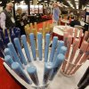 Small wooden souvenir bats are displayed at the baseball winter meetings trade show, Tuesday, Dec. 4, 2012, in Nashville, Tenn. Companies pitch their wares to both major and minor league teams, and that includes every product imaginable. (AP Photo/Mark Humphrey)
