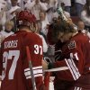 Photo -   Phoenix Coyotes' Mike Smith, right, pauses as teammate Raffi Torres (37) see how Smith is after spending over five minutes injured on the ice being attended to my team doctors after taking a hard hit by Chicago Blackhawks' Andrew Shaw during the second period in Game 2 of an NHL hockey Stanley Cup first-round playoff series Saturday, April 14, 2012, in Glendale, Ariz.(AP Photo/Ross D. Franklin)