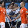 Photo - Argentina players celebrate after winning a shootout at the end of the World Cup semifinal soccer match between the Netherlands and Argentina at the Itaquerao Stadium in Sao Paulo Brazil, Wednesday, July 9, 2014. Argentina won 4-2 on penalties after the match ended 0-0 after extra time.  (AP Photo/Manu Fernandez)