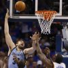 Memphis\' Marc Gasol (33) shoots over Oklahoma City\'s Serge Ibaka (9) and Kendrick Perkins (5) during Game 7 in the first round of the NBA playoffs between the Oklahoma City Thunder and the Memphis Grizzlies at Chesapeake Energy Arena in Oklahoma City, Saturday, May 3, 2014. Photo by Nate Billings, The Oklahoman