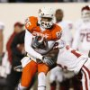 OSU\'s Damian Davis runs after catch and is hit by Keenan Clayton of OU during the first half of the college football game between the University of Oklahoma Sooners (OU) and Oklahoma State University Cowboys (OSU) at Boone Pickens Stadium on Saturday, Nov. 29, 2008, in Stillwater, Okla. STAFF PHOTO BY NATE BILLINGS