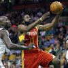 Houston Rockets\' James Harden (13) goes up to shoot past Boston Celtics\' Kevin Garnett (5) as Paul Pierce, right, watches during the first quarter of an NBA basketball game in Boston, Friday, Jan. 11, 2013. (AP Photo/Michael Dwyer) ORG XMIT: MAMD101