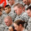 Troops bow their heads during the invocation at the 45th Infantry Brigade Combat Team deployment ceremony inside the Cox Convention Center, Wednesday, Feb. 16, 2011. Photo by Jim Beckel, The Oklahoman
