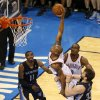 Oklahoma City\'s Caron Butler (2) goes by Memphis\' Marc Gasol (33) for a dunk as Mike Conley (11) and Oklahoma City\'s Serge Ibaka (9) watch during Game 1 in the first round of the NBA playoffs between the Oklahoma City Thunder and the Memphis Grizzlies at Chesapeake Energy Arena in Oklahoma City, Saturday, April 19, 2014. Photo by Nate Billings, The Oklahoman
