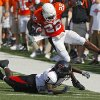 Oklahoma State\'s Dantrell Savage (22) is knocked out of bounds by Texas Tech\'s Jamar Wall (3) during the first half of the college football game between the Oklahoma State University Cowboys (OSU) and the Texas Tech University Red Raiders (TTU) at Boone Pickens Stadium on Saturday, Sept. 22, 2007, in Stillwater, Okla. By MATT STRASEN, The Oklahoman
