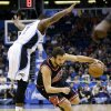 Chicago Bulls\' Marco Belinelli, right, of Italy, drives the ball to the basket as Orlando Magic\'s Kyle O\'Quinn (2) tries to avoid running into him during the first half of an NBA basketball game, Wednesday, Jan. 2, 2013, in Orlando, Fla. (AP Photo/John Raoux)