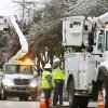 ICE STORM, POWER CREW, REPAIR, RESTORE: Utility crews from Rock Springs, TX, were in this Midwest City neighborhood near SE 15 and Avery early Wednesday, Dec. 12, 2007. They are with Quanta Utility Services. A crew of 20 men drove 15 trucks for 17 hours yesterday to arrive in Oklahoma City last night. A worker said they generally work a 17-hour day restoring power during a winter storm. By Jim Beckel, The Oklahoman. ORG XMIT: KOD
