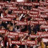 The crowd holds banners for a cheer before the college football game between the University of Oklahoma Sooners (OU) and the Texas A&M at the Gaylord Familiy-Oklahoma Memorial Stadium on Saturday, Oct. 31, 2009, in Norman, Okla. Photo by Steve Sisney, The Oklahoman