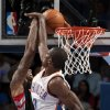 Oklahoma City\'s Serge Ibaka (9) blocks the shot of a Toronto\'s player during the NBA basketball game between the Oklahoma City Thunder and the Toronto Raptors at Chesapeake Energy Arena in Oklahoma City, Sunday, April 8, 2012. Photo by Sarah Phipps, The Oklahoman.