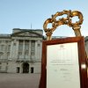 An easel stands in the forecourt of Buckingham Palace in London carrying an official document to announce the birth of a baby boy, at 4.24pm to the Duke and Duchess of Cambridge at St Mary\'s Hospital, Monday July 22, 2013. The child is now third in line to the British throne. (AP Photo/John Stillwell, Pool)