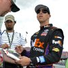 NASCAR Sprint Cup series driver Denny Hamlin signs autographs for fans during practice at the Talladega Superspeedway in Talladega, Ala., Friday, May 3, 2013. (AP Photo/Rainier Ehrhardt)