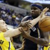 Photo - Indiana Pacers' Ben Hansbrough (23) and Memphis Grizzlies' Zach Randolph (50) battle for a rebound during the second half of an NBA basketball game, Monday, Dec. 31, 2012, in Indianapolis. Indiana won 88-83. (AP Photo/Darron Cummings)