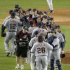 Detroit Tigers congratulate one another after beating the New York Yankees 6-4 in Game 1 of the American League championship series early Sunday, Oct. 14, 2012, in New York. (AP Photo/Charlie Riedel)