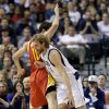 Photo - Houston Rockets' Carlos Delfino (10), of Argentina, fouls Dallas Mavericks' Dirk Nowitzki (41), of Germany, as Nowitzki drives to the basket in the first half of an NBA basketball game, Wednesday, March 6, 2013, in Dallas. (AP Photo/Tony Gutierrez)