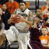 Photo - OSU's Michael Cobbins (20) grabs a rebound next to Texas A&M's Keith Davis (4) in the first half of a men's college basketball game between the Oklahoma State University Cowboys and Texas A&M University Aggies at Gallagher-Iba Arena in Stillwater, Okla., Saturday, Feb. 25, 2012. OSU won, 60-42. Photo by Nate Billings, The Oklahoman