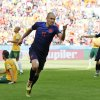 Photo - Netherlands' Arjen Robben (11) celebrates after scoring his side's first goal during the group B World Cup soccer match between Australia and the Netherlands at the Estadio Beira-Rio in Porto Alegre, Brazil, Wednesday, June 18, 2014. (AP Photo/Jon Super)