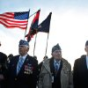 Photo - From left, World War II veterans of the U.S. 29th Infantry Division, Hal Baumgarter, 90 from Pennsylvania, Steve Melnikoff, 94, from Rhode Island, Don McCarthy, 90 from Maryland, and Morley Piper, 90, from Massachusetts, attend a D-Day commemoration, on Omaha Beach, western France , Friday June 6, 2014. Veterans and Normandy residents are paying tribute to the thousands who gave their lives in the D-Day invasion of Nazi-occupied France 70 years ago. World leaders and dignitaries including President Barack Obama and Queen Elizabeth II will gather to honor the more than 150,000 American, British, Canadian and other Allied D-Day troops who risked and gave their lives to defeat Adolf Hitler's Third Reich. (AP Photo/Thibault Camus)