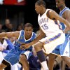 Photo - Chris Paul of New Orleans tries to drive past Oklahoma City's Kevin Durant during the NBA basketball game between the Oklahoma City Thunder and the New Orleans Hornets at the Ford Center in Oklahoma City, Wednesday, January 6, 2009. Photo by Bryan Terry, The Oklahoman ORG XMIT: KOD