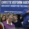 People look on as Mike Grasso, right, asks New Jersey Gov. Chris Christie a question during a town hall meeting at Saint Mary\'s of The Pines Church Parish Wednesday, Jan.16, 2013, in Manahawkin, N.J., Grasso wanted to know when the dredging and removal of debris will begin in the bay area of Manahawkin. Christie said there are possibly cars, boats and houses submerged in waters around the Jersey shore because of Superstorm Sandy. (AP Photo/Mel Evans)