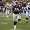 New England Patriots running back LeGarrette Blount (29) heads down field for a 75 yard touchdown run during the second half of an AFC divisional NFL playoff football game against the Indianapolis Colts in Foxborough, Mass., Saturday, Jan. 11, 2014. (AP Photo/Matt Slocum)